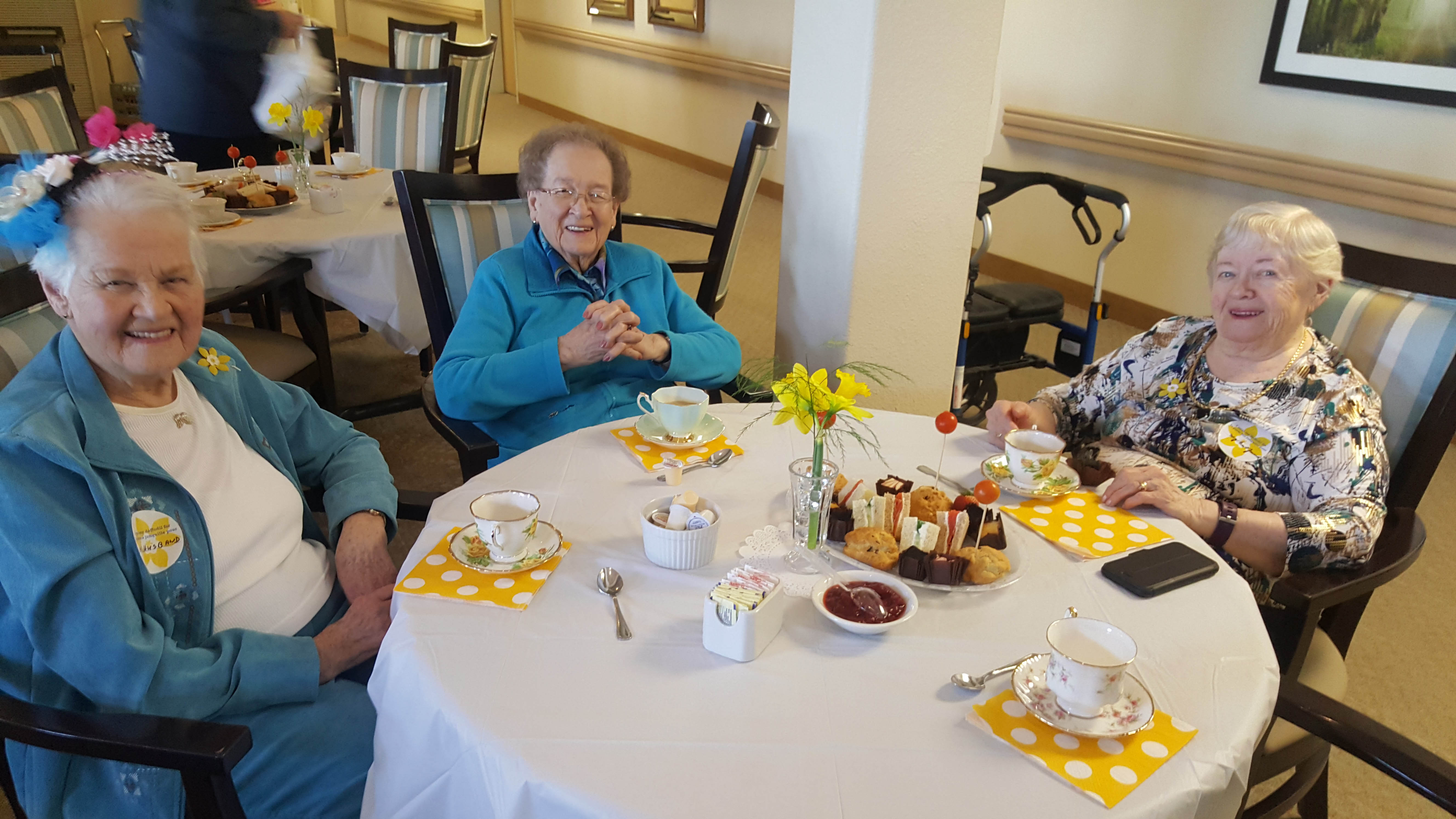 Three ladies enjoying a daffodil tea party.