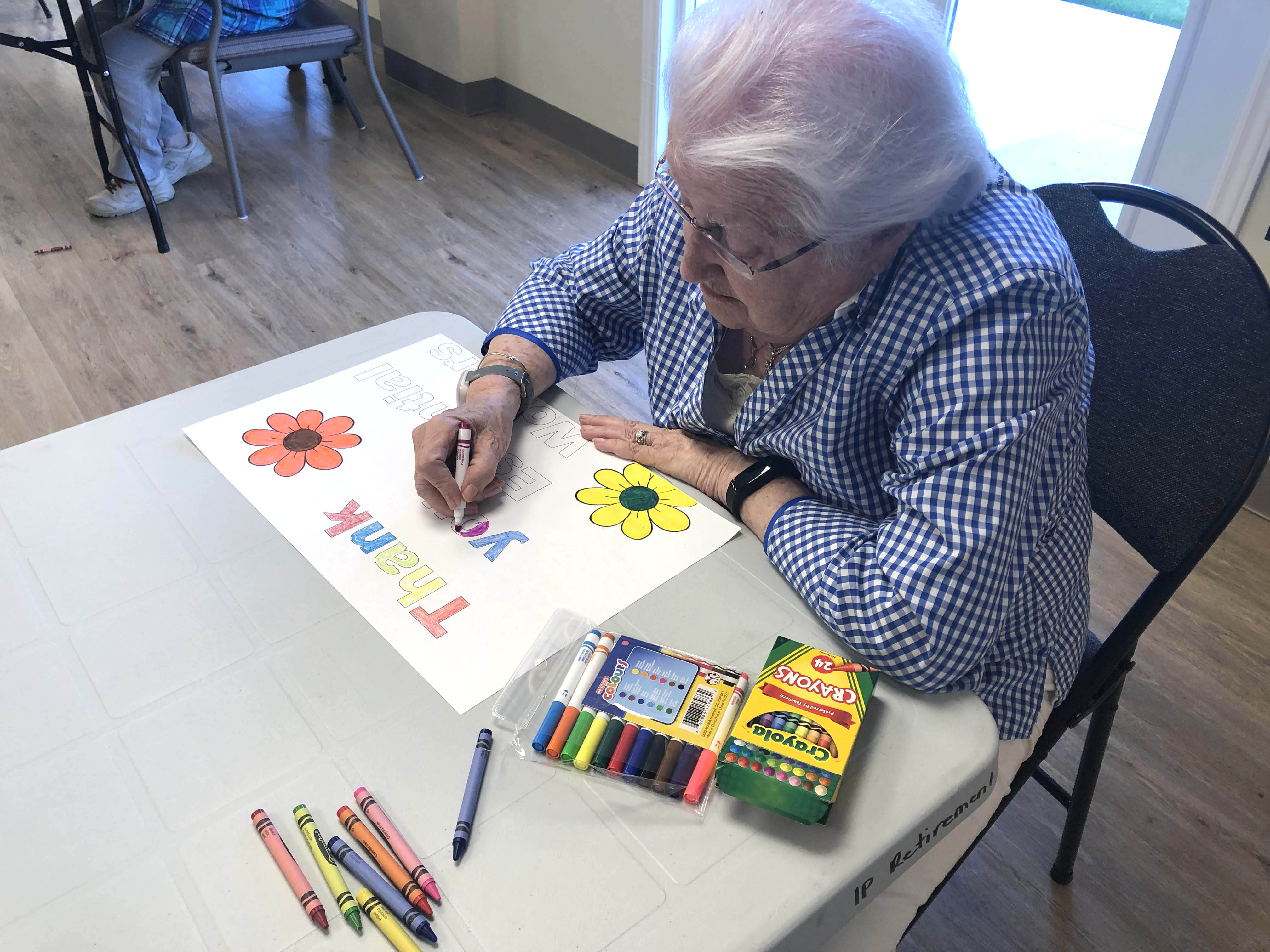 A resident drawing a picture.