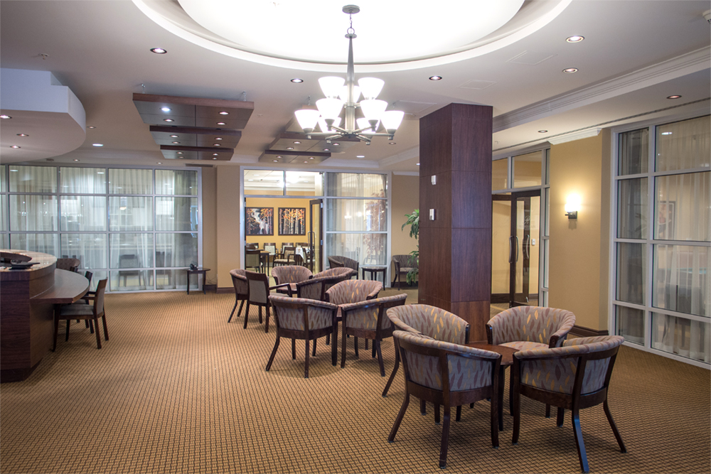 Dining area with bar at Red Oak Retirement Residence