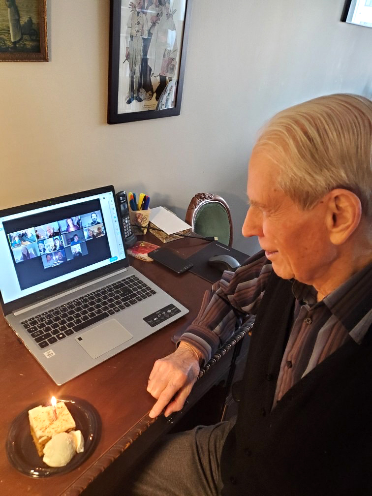 A resident celebrating his birthday with his family over video chat.