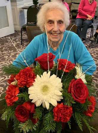 A resident with a bouquet of flowers.