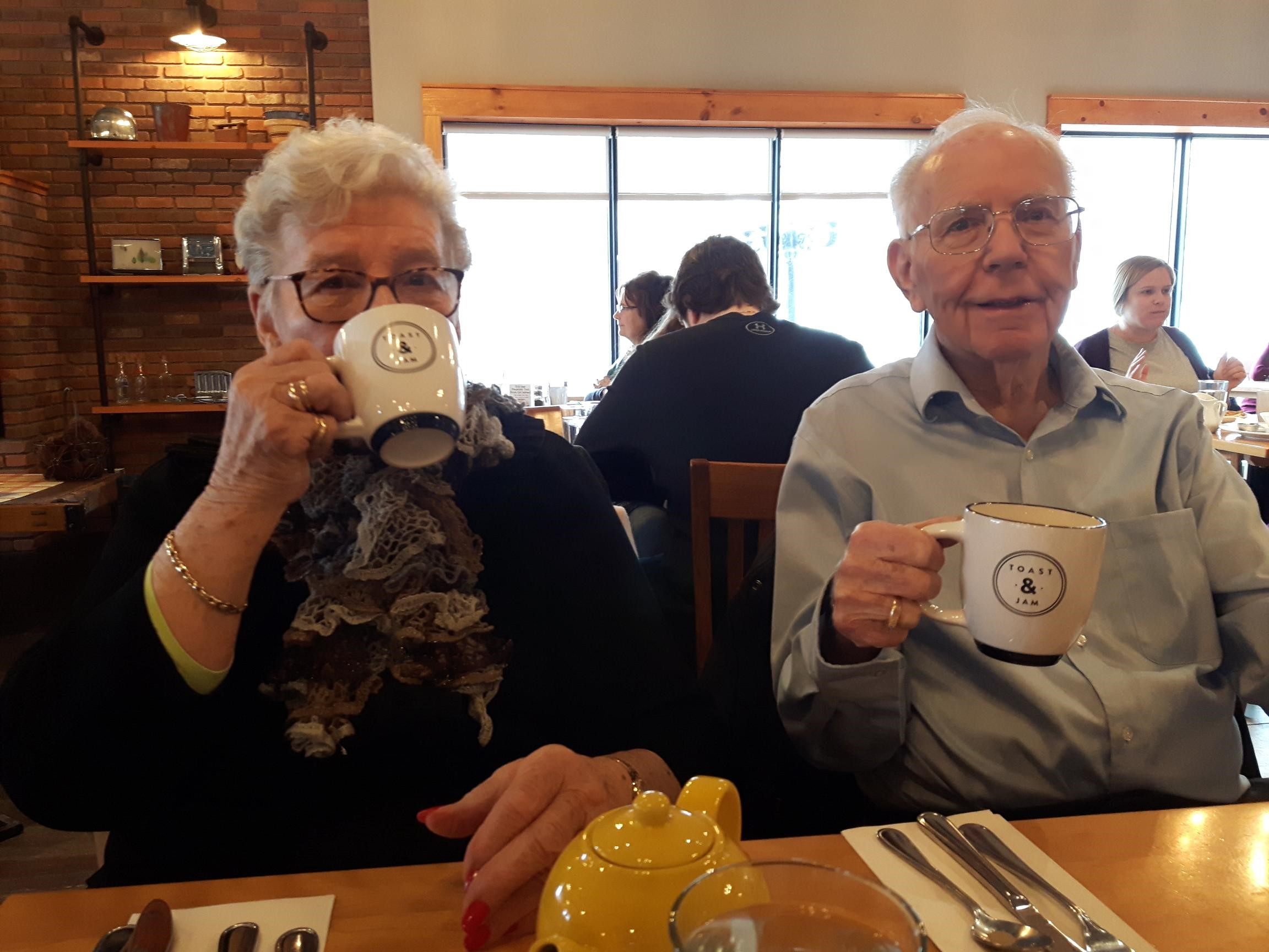A lady and gentleman sipping tea at the restaurant Toast and Jam.