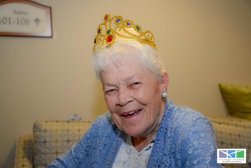 A senior who was crowned prom queen at the senior prom party.