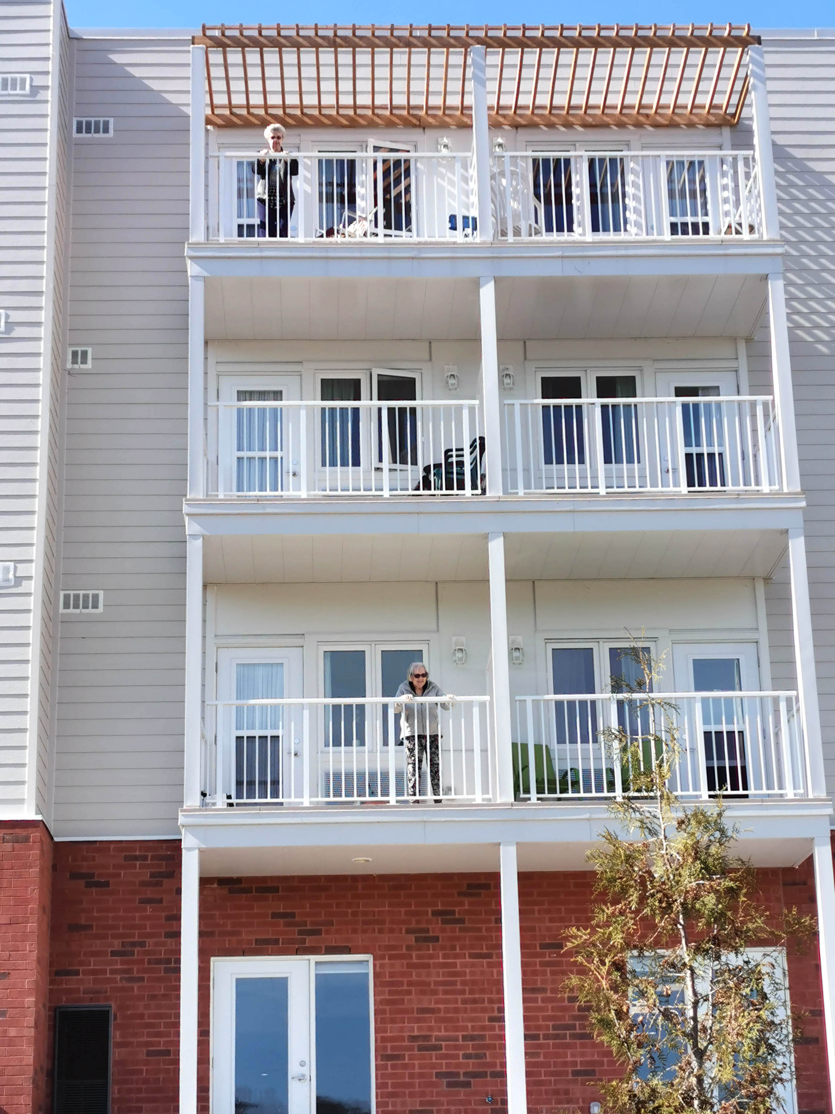 Residents on their balconies enjoying the warm weather.