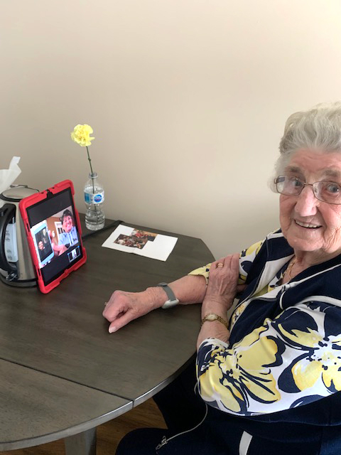 A resident on a video call with her family.