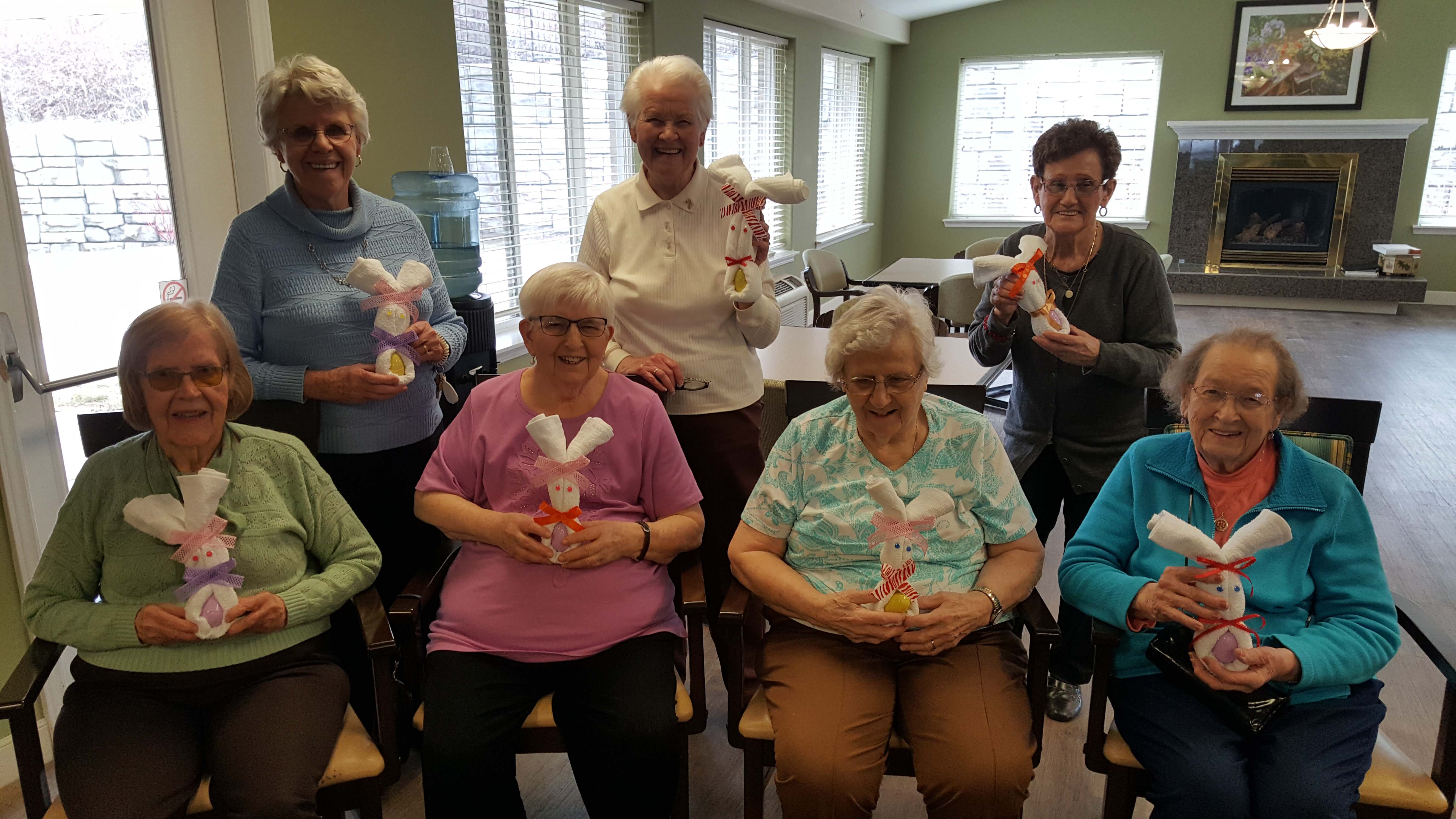 A group of seniors creating Easter-inspired crafts.