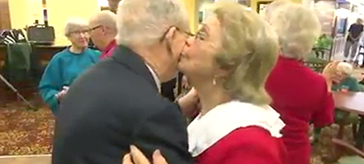 image of a resident couple of Waterford Barrie Retirement Resident enjoying a dance in the celebration of their 70+ years of love