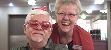photo of a resident and a team member from Kensington Court Retirement Residence enjoying the Valentine celebration event.