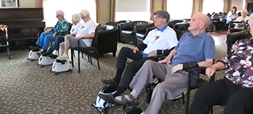 picture of residents of Cedarvale Lodge Retirement Residence virtually cycle around the world