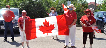 President Tammy Paglia from the Bradford Legion held a flag with friends at the lot of the Bradford Valley Care Community on Canada Day.