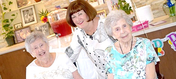 photo of Anna Smith, right, celebrates her 100th birthday with sister Flo Moore and daughter Francie Heagney, at Island View Suites.