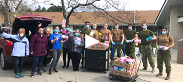group photo of volunteers delivered 82 hand-sewn quits as Mother's Day gifts to Altamont Care Community
