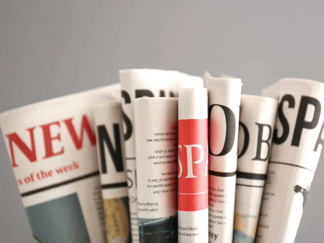 close-up of different newspapers