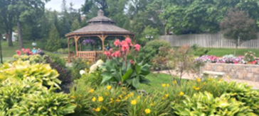 Image of the beautiful garden view of the grounds, including the resident garden, plants and the gazebo.