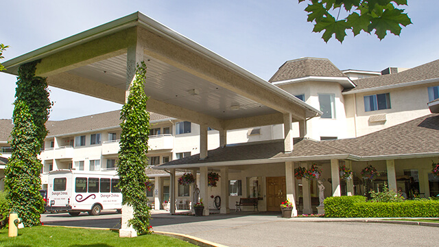 image of the front entrance of Okanagan Chateau Retirement Residence in Kelowna