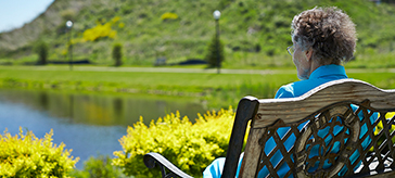 image of a female senior sitting at the beautiful garden at Kingsmere Retirement Residence