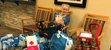 picture of resident of Cedarvale Lodge Retirement and Care Community showcase the 300lb donation