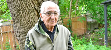 image of Douglas stood in the garden of his retirement residence