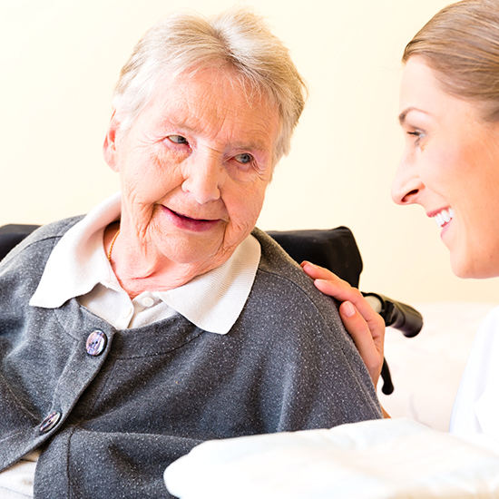 image of a happy female senior sitting in a relaxing area