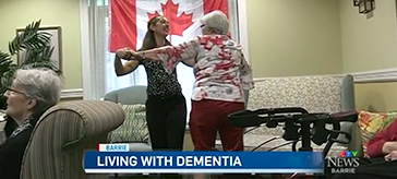 picture of Mildred dancing with one of the female residents in Waterford Barrie Retirement Residence