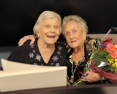 image of two happy female seniors smiling toward the camera