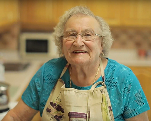 image of a happy female senior in a kitchen setting