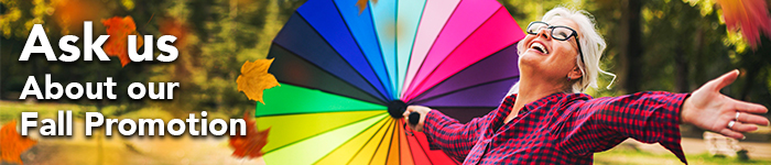 A Fall promotion web banner features a happy female senior, one hand holding a colourful umbrella and the other hand tries to catch some falling leaves.