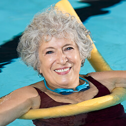 image of a happy female senior enjoying her morning swim