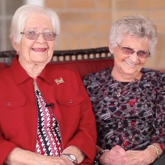 photo of two happy female residents smiling toward the camera.
