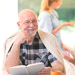 image of a happy male senior listening to other person talking