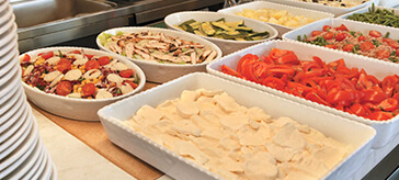 image of different trays of ready to serve food such as vegetables and noodles