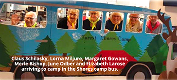 Group photo of residents arriving to camp in The Shores camp bus.