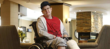 image of Craig Beaton who broke his legs in the OC Transpo bus crash and is convalescing at Red Oak Retirement Residence.