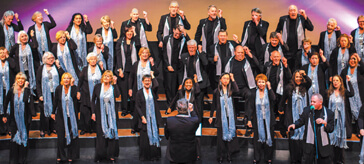 image of the 50-strong Maple Leaf Singers perform more than 12 high-energy concerts a year – often for audiences who would not otherwise get to see a fully choreographed theatre-style show.