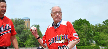 image of Kenneth threw the opening pitch in the Baseball Oshawa Military Appreciation Week game