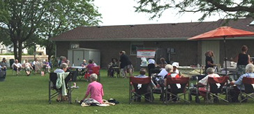 picture of residents of Island Park Retirement Residence enjoyed the barbecue at Old Mill Park and helped raise money at the same time.