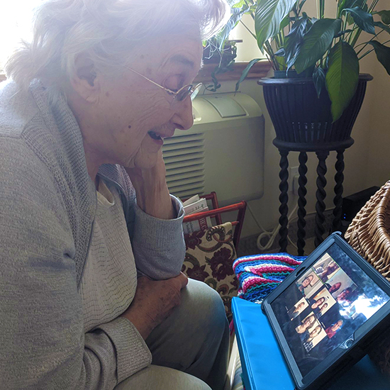image of a female senior having a virtual meeting with her family